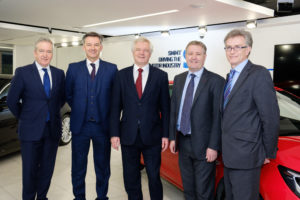 EDITORIAL USE ONLY Ministers meet executives from across the UK automotive industry to discuss the sector's priorities for exiting the EU. Pictured left to right: Adrian Hallmark, Director of Strategy, Jaguar Land Rover; Mike Hawes, SMMT Chief Executive; David Davis, Secretary of State for Exiting the European Union; Rory Harvey, Chairman and MD, GM - Vauxhall UK; and Ian Howells, Senior Vice President, Honda Motor Group. PRESS ASSOCIATION Photo. Picture date: Monday December 12, 2016. Photo credit should read: Frantzesco Kangaris/PA Wire